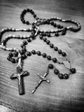 Two rosaries. Artistic look in black and white. Royalty Free Stock Images