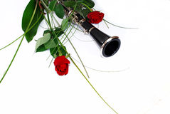 Two rose clarinet composition. Two red rose clarinet composition over white stock photo
