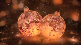 Two Rotating Christmas Gold Ice Baubles snow colorful petals background loop