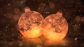 Two Rotating Christmas Golden Ice Glass Baubles Decorations snow background loop