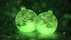 Two Rotating Christmas Green Ice Glass Baubles Decorations snow background loop