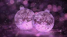 Two Rotating Christmas Pink Ice Glass Baubles snow red balls background loop
