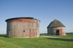 Two round barns. Stock Photos