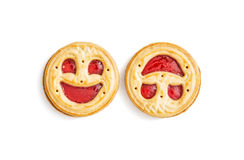 Two round biscuits smiling faces, humorous sweet food, isolated. Two round jam biscuits smiling faces isolated on the white background. Humorous sweet food stock photography