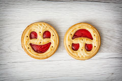 Two round biscuits smiling faces, humorous sweet food Stock Photography