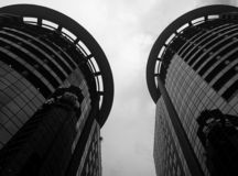 Two Round Buildings in the city stock images