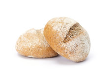 Two round buns sprinkled with flour. On white background Royalty Free Stock Photos