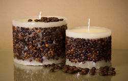 Two round coffee candles and coffee beans on brown Stock Photography