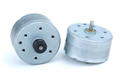 Two round DC electric motors Stock Photos