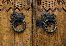 Two round door handles. Closeup on ornate round metal door handles Royalty Free Stock Images