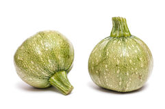 Two round green courgettes Stock Images