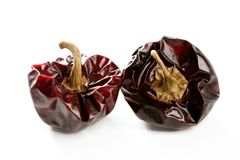 Two round Mediterranean dried dark red peppers Royalty Free Stock Photos