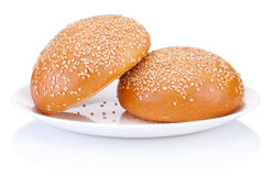 Two round sandwich bun with sesame seeds on a plate isolated Stock Photography