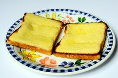 Two rounds of cheese on toast. Royalty Free Stock Photos