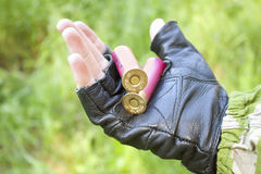 Two rounds on hand hunter Royalty Free Stock Image