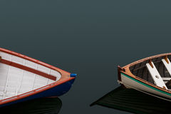Two row boats pointed at each other Royalty Free Stock Photography