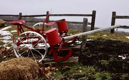 Two Row Horse/Mule Driven Corn Planter. This is a Winter picture of an antique and painted two Row Horse/Mule Driven corn planter on display on the grounds of Stock Photography