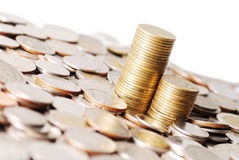 Two row stack coins on many coins background. Two row stack of coins on white background Royalty Free Stock Image