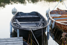 Two rowboat in calm water in the harbor royalty free stock photography