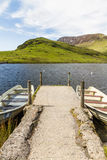 Two rowing boats by jetty, Snowdonia. Stock Photo