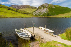 Two rowing boats by jetty, Snowdonia. Stock Photos