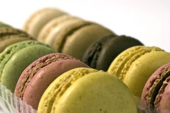 Two rows of beautiful macaroons. Macaroons; beautifully-coloured macaroons on a white ground Royalty Free Stock Images