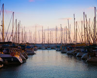 Two rows of boats on pier in the evening Stock Photos