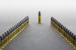Two rows of cartridges and a chief Royalty Free Stock Images