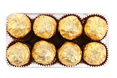 Two rows of chocolate bonbons in box. Royalty Free Stock Photography