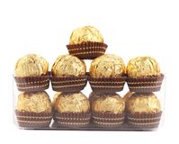 Two rows of chocolate bonbons in box. Royalty Free Stock Photos
