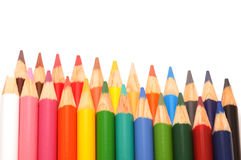 Two rows of coloring pencils Stock Images