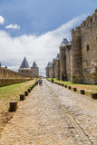 Two rows of defensive walls of the fortress of Carcassonne, France. UNESCO List. Fortress of Carcassonne - a medieval architectural complex, located in the Stock Photography