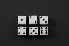 Two rows of dice showing numbers one to six Stock Photo