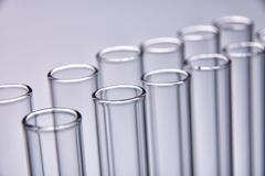 Row of empty test tubes gray background Stock Photography