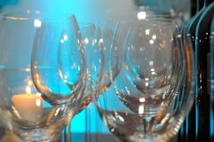 Two rows of empty glasses on a table royalty free stock photo