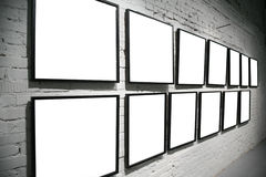 Two rows frames on brick white wall Stock Photo