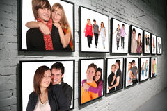 Two Rows Frames With People On Brick White Wall Stock Photography