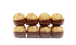 Two rows of gold chocolate bonbons. Royalty Free Stock Image