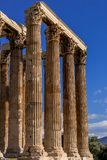 Greek columns in Athens. Two rows of greek columns against blue sky Stock Photos