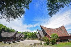 Two rows of Jabu houses and smaller rest area of Toba Batak traditional architecture at Samosir Island, Lake Toba, North Sumatra. Located within the popular stock photo