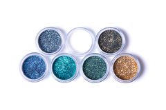 Two rows of metallic glitters in jars Stock Photography