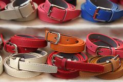 Two rows of multicolored women's leather belts Royalty Free Stock Image