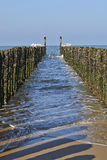 Between the two rows of poles of the breakwater Royalty Free Stock Photos