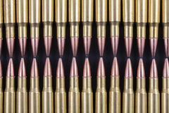 Two rows of rifle rounds touching. Two rows of large rifle rounds touching Royalty Free Stock Images