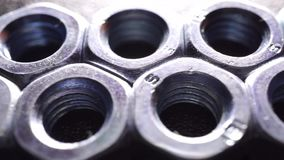 Two rows of steel nuts, macro dolly shot stock video