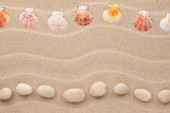 Two rows of stones and shells on the sand Royalty Free Stock Image