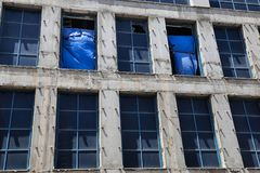 Two rows of windows on the building façade stock photography
