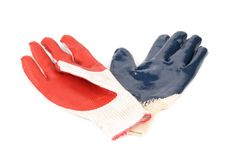 Two rubber gloves red and blue. Stock Photo