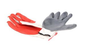 Two rubber gloves red and gray. Stock Images