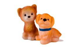 Two rubber toy dogs. Two rubber toy dogs isolated on white Stock Images
